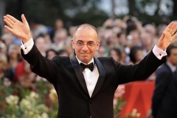 Italian director Giuseppe Tornatore wave